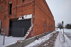 brewery block (twurdemann) Tags: architecture bottlingplant brewery breweryblock brick building city cold downtown fence fujixt1 industrial northernbreweries northernontario ontario saultstemarie snow soofallsbrewingcompany springstreet toad urban viveza winter xf1855mm