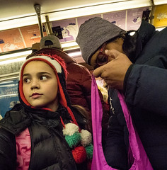 Mother and Daughter on Subway - 1 (UrbanphotoZ) Tags: girl woman mother daughter knithat pompoms sack hotpink subway car upperwestside manhattan 1train newyorkcity newyork nyc ny