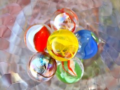 1 When Things Blend In (Robert Cowlishaw-Mertonian) Tags: mertonian colors glass canon powershot g7x mark ii canonpowershotg7xmarkii yellows greens reds blues whites marbles robertcowlishaw bright hope clear colours circularity blending balance positivity form objects