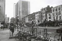 Whitechapel High Street (goodfella2459) Tags: nikon f65 analog ilford fp4 plus 125 35mm blackandwhite film whitechapel high street east end london milf bwfp jacktheripper