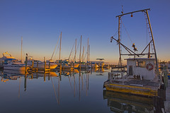 _40A6653 (ChefeGrande) Tags: texas southtexas gulfofmexico coastal marina shrimpboat sailingboats pleasureboats workingboat reflection landscape sunset seashore seaside silhouette serene water docked