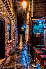 Bar In The Alley (Light+Shade [spcandler.zenfolio.com]) Tags: 2016 england northyorkshire york yorkshire ©stephencandlerphotography alley spcandler stephencandlerphotography httpspcandlerzenfoliocom stephencandler uk lightshade night time nighttime cafe bar snickleway lights lamps wet geotagged