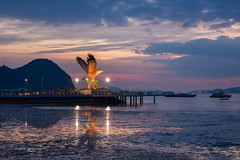 Eagle of Langkawi (pietkagab) Tags: eagle statue sunset monument twilight nightfall lowtide reflection color sky malaysia southeast asia malay pier water sea andaman pietkagab photography pentax piotrgaborek pentaxk5ii travel trip tourism sightseeing adventure evening