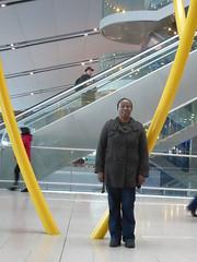 Happy to see Louise (seikinsou) Tags: spring kenyatour udp urbandevelopmentprogramme ireland dublin airport sculpture terminal2 arrival yellow