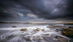 Newbiggin Storm Clouds (ianbrodie1) Tags: newbigginbythesea storm stormy angry cloud cloudsstormssunsetssunrises coast coastline rocks church statue sunrise northumberland leefilters nikon d750
