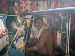 Peshawar Rikshaw Driver (Shahid A Khan) Tags: pakistan peshawar rikshaw tuk driver portrait street travel photography kpk khyberpukhtoonkhuwa qissa khuwani sakhanphotography shahidakhan nostalgic vehicle transport olympus