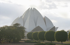 Lotus Temple (Amickman) Tags: park travel india white house abstract reflection building tourism beautiful sunshine architecture modern temple freedom design wings worship peace symbol lotus outdoor decorative delhi islam religion buddhism arches landmark location tourist structure symmetry petal believe getty destination christianity ornate shape hinduism futuristic gettyimages gettyimagesmiddleeast