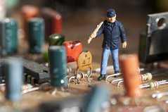 Maintenance Man (sazbow39) Tags: man color colour colors work fun miniature colorful colours little small working mini electronics maintenance worker colourful circuits littlepeople electronic circuit circuitboard curcuits