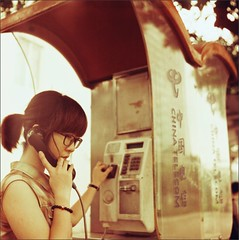 Little White #19 (Araakii) Tags: girlfriend portrait pay telephone booth telecom panyu guangzhou guangdong china seagull  4a tlr 75mm f35 lomography redscale xr 50200 medium format 6x6 negative film