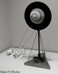 """MOMA Art by Marcel Duchamp born France 1887-1968 """"Rotary Demisphere (Precision Optics) 1925"""" Painted papier-mache demisphere on velvet covered disk., copper coller, plexiglass dome, motor, pulley. www.dada-companion.com (nrhodesphotos(the_eye_of_the_moment)) Tags: bw art metal blackwhite painted moma velvet disk dome copper plexiglas motor machines collar pulley papiermache marcelduchamp metalstand rotarydemisphere demisphere precisionoptics nrhodesphotosyahoocom wwwflickrcomphotostheeyeofthemoment aboveandbeyondlevel1 dsc4226nhr wwwdadacompanioncom"""