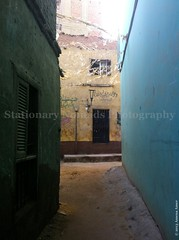 (Stationary Nomads) Tags: life street door old blue boy house building home nikon colours bricks rustic egypt daily cairo tiles egyptian walls narrow giza faisal d3000 amenaamer