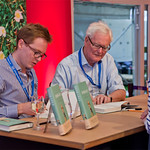 Douglas Hurd and Edward Young sign copies of their book Disraeli