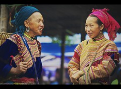 A Colorful Morning at the Sunday Bac Ha Market in Northeastern Vietnam; Southeast Asia (Sam Antonio Photography) Tags: travel portrait people flower fashion vertical horizontal female outdoors photography togetherness clothing women asia southeastasia day vietnamese pattern looking adult market embroidery candid hill sunday north streetphotography tribal vietnam tribe multicolored ethnic cultures twopeople adultsonly sapa hmong laocai ethnicity bac mong indochina humaninterest sellers headwear bacha ethnicminority travelphotography senioradult flowerhmong traditionalclothing colorimage canon70200f4 vietnameseculture maturewomen travelportrait matureadult northvietnam bachamarket vietnamesewoman indigenousculture focusonforeground onlywomen minoritytribes vietnamtravel laocaiprovince canoneos5dmarkii asianandindianethnicities samantoniophotography colorfulcloth northeasternvietnam daytripfromsapa vietnamphotographytips sundaymarketinbacha traditionalcolorfulclothes