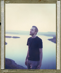 Lost In A Blue Landscape. (goddamnanalog) Tags: blue portrait lake selfportrait water dream instant 4x5 nm polaroid59