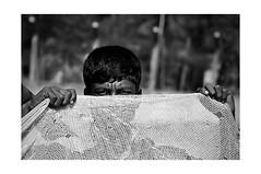 Live in fear (Iftekhar Jamil) Tags: life sea bw white black net fisherman nikon bayofbengal d90 coxbazar livehood fishingrural reknaf