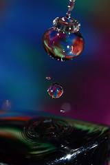 pretty swirly drops on tap (joy's girl) Tags: macro reflection water waterdrop refraction reverselens waterart