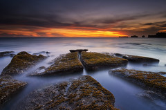 Belahan  [Explored] (eggysayoga) Tags: sunset sea bali sun seascape beach water rock indonesia landscape nikon asia hard tokina filter shore 09 lee nd bluehour 06