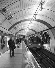 Down in a tubestation at midnight (gopper) Tags: tube london underground bw monochrome greenpark picadilly line miserable midnight thejam tune gb uk train waiting dark dismal ngc nikon d5300 tamron