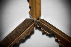 Keys To Success (JDWCurtis) Tags: madeofmetal metal macro macromonday keys teeth keyteeth triangle triumverate angles monday bronze keysteeth bite vignette