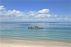 A Zanzibar Morning (The Spirit of the World) Tags: zanzibar tanzania island indianocean ocean seascape clouds waves shallowwaves snad beach paradise africa dow boat eastindia