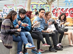 lunch (art crimes) Tags: tourists eating snacking sitting market barcelona graffiti streets walls