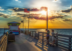 Fun Times (DonMiller_ToGo) Tags: beachlife flag sunsetmadness sunsets pier people goldenhour florida hdr sharkys onawalk hdrphotography sky sunsetsniper 3xp d810 outdoors clouds