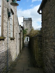 Kendal, Cumbria - back alley - Tanners Yard (rossendale2016) Tags: ceiling roof rounded round archway arch drystone dry random alleyway walls high narrow local quarried quarries flags stone old alley street back england cumberland cumbria kendal tanners yard ginnel ancient walkway path pathway enclosed