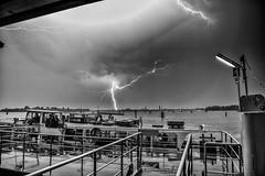 Tricks of Light (U1D2X) Tags: venezia venice temporale tempesta tuono fulmine saetta thunder tempest lightning lido bianco e nero blackwhite actv vaporetto nuvole pioggia rain clouds dark sky