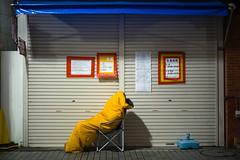 L1004143 (Camera Freak) Tags: 170422tokyo tokyo leica m10 japan 50mm summilux kameari sleeping tickets shutter night midnight yellow waiting queueing lining 日本 東京 亀有 夜