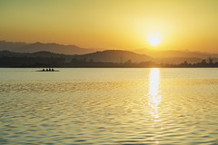 Crack of the dawn............. (Rambonp:loves all creatures of this universe.) Tags: sukhnalake chandigarh birds goose sunrise sun sunrays blue red yellow green water reflectiontrees sky clouds nature landscape wallpaper paradise silhouette mountains morning india उदयाचल atthecrackofdawn मुँहअँधेरे canoeing sportsman sports rowing