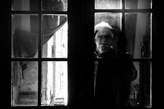 I'll be back (Tomasz Aulich) Tags: blackandwhite monochrome man people human light streetphoto street fotografiauliczna fotografiaczarnobiala glass door poland europe travel nikon sigmalens urban hands hair face