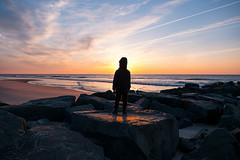 Alive (DJawZ) Tags: sunrise beach lbi ocean atlantic sand rocks sky clouds sun morning spring child son fujifilm xt2