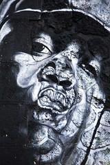 Regard de pierre (Gerard Hermand) Tags: 1704027275 gerardhermand france paris canon eos5dmarkii formatportrait homme man regard glance rue street art streetart mur wall pierre stone peinture paint bombe spray graffiti canal ourcq graf