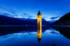 Lady of the Lake (J C Mills Photography) Tags: church tower lake reservoir mountains tyrol sudtyrol italy italia longexposure bluehour landscape reschensee south reschen lago di resia