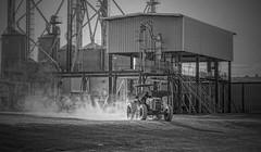 Let's Roll! (TuthFaree) Tags: peanuts tractor dusty dust ga georgia swga worthcounty steel storage tanks wagons industry peanutcapital