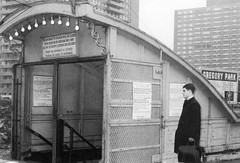 An entrance to a carnival ride? Nope. It's actually an alternative entrance to the PATH train Grove Street station from Henderson Street and Railroad Avenue. Signs for the new Gregory Park apartments in the background. Jersey City. 1965 (wavz13) Tags: vintagetrainstations oldtrainstations oldphotographs oldphotos 1960sphotographs 1960sphotos oldphotography 1960sphotography vintagephotographs vintagephotos vintagephotography filmphotos filmphotography historicphotographs historicphotos historicphotography oldbuildings abandonedbuildings railroadphotos railroadphotography railroads vintagerailroads vintagerailroadphotography oldrailroads oldrailroadphotography antiquetrainstations jerseycityphotographs jerseycityphotos oldjerseycityphotography oldjerseycityphotos oldjerseycity vintagejerseycity vintagejerseycityphotography jerseycityhistory urbanphotography urbanphotos urbanscenes cityphotography cityphotos newjerseyphotographs newjerseyphotos oldnewjersey vintagenewjersey newjerseyhistory vintagerailroad oldrailroad vintagerailroadstations vintagerailroadstation oldrailroadstations oldrailroadstation