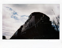 (|Digital|Denial|) Tags: instaxwide fujifilm instantphotography prairies analog film freighttrain trains oncoming stark dramaticlighting sky clouds railroad traintracks