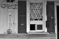 The Office (jcdriftwood) Tags: office motel abandoned disrepair dilapidated bell sign neon neonlight mailbox blackandwhite shutters window slidingwindow broken rundown