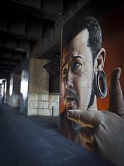 In that direction She left (buddah1888) Tags: smug man dark mural glasgow central bridge colums street earing eyes piercings bokeh artist buddah1888 artwork