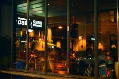 Through a pub window from the sidewalk near the railway station in King street Newtown NSW at night - Autumn 2017 (fantasma B slide) (nicephotog) Tags: window reflection ghost fantasma night people patrons customers pub drinking entertainment relaxation evening afterhours newtown sydney nsw saloon street sidewalk town local