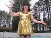 Dancing outside (Paula Satijn) Tags: sexy hot girl lady gurl tgirl dress skirt miniskirt gold golden outside happy fun joy transvetite tranny smile