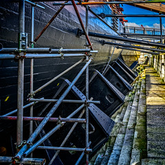 Supporting and caring for the mighty hull in dry dock (Brett of Binnshire) Tags: historicalsite sailingship ship portsmouth lightroomhdr lrhdr locationrecorded nationalmuseumoftheroyalnavy hampshire highdynamicrange boat hdr manipulations museum england hmsvictory admiralnelson