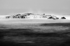 Eternal Tides (Alexander Ipfelkofer) Tags: ocean longexposure travel blackandwhite seascape beach rock indonesia landscape waterfall asia waves lagoon adventure laguna tides pari bayah sawarna banten