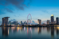 Singapore skyline (Oscar Tarneberg) Tags: sky reflection water skyline clouds skyscraper singapore southeastasia sands 1740mm goldenhour 1740l marinabay singaporeflyer canon5d3