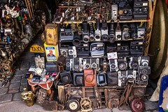 Cameras for sale in the Souks (Tracy Ward Photography) Tags: life africa street city light portrait mountains landscape photography interesting cityscape market muslim spice working culture mosque morroco busy morocco maroc atlas marrakech souk medina marrakesh souks smelly marroc riad low cinamon peaple light north africa