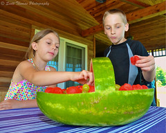 Watermelon Picnic (Scottwdw) Tags: wood family boy party summer people house newyork girl fruit kids children table carved nikon picnic berries basket sister eating brother stripes treats flash watermelon celebration porch grapes redwood cloth bounced rearsync d700 afszoomnikkor2485mmf3545gifed sb700 scottthomasphotography