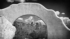 Arch at Honey Bee Canyon Trailhead (Paul Pomeroy) Tags: arizona blackandwhite bw clouds landscape arch archway 169 santacatalinamountains orovalley tabletopmountain cinemaratio