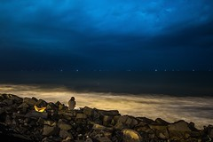 Night @ Pondy Beach (Picsnapr) Tags: ocean blue friends sea sky india white beach night clouds relax rocks waves sitting peace slow stones peaceful resting pondicherry indiaocean