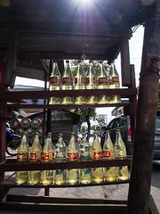 PSR_131022_220180 (prosenblum) Tags: travel indonesia rack roadside gasoline fuel cokebottles lembeh topside import131022 alexmustardmacroworkshop2013
