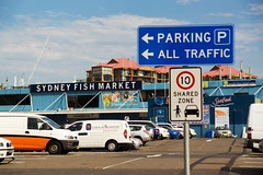 Sydney Fish Market (Kokkai Ng) Tags: road travel blue sky food cloud fish industry tourism car sign retail outdoors day market sydney entrance australia business vehicles newsouthwales seafood parked pyrmont van carpark trade fishmarket consumerism sydneyfishmarket buildingentrance buildingexterior builtstructure retailplace